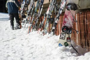 Skis and Snowboards on snow