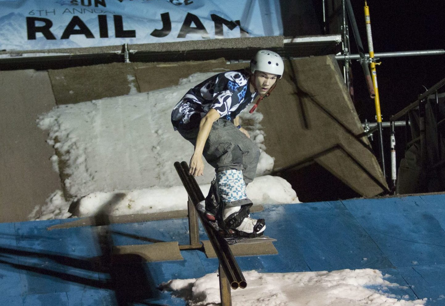 Snowboarder on a rail
