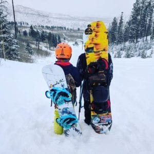 Snowboarders hiking up